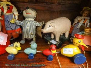 Antique pull toys such as ducks in a row, Booth Q5