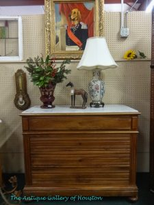 Four drawer chest with a marble top, Booth F 4b