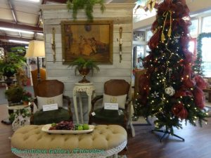 Tufted bench, two upholstered arm chairs with holiday decor