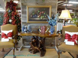 Rustic live edge table/desk, two upholstered arm chairs, and holiday decor